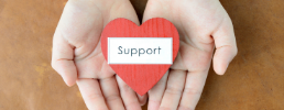 Hands holding support heart
