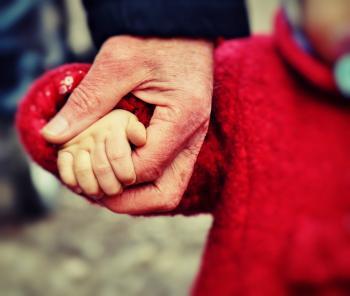 grandparent holding grandchilds hand