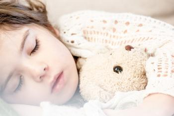 Child sleeping with stuffed animal