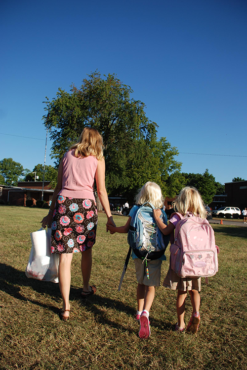 Mom and daughters back to school.