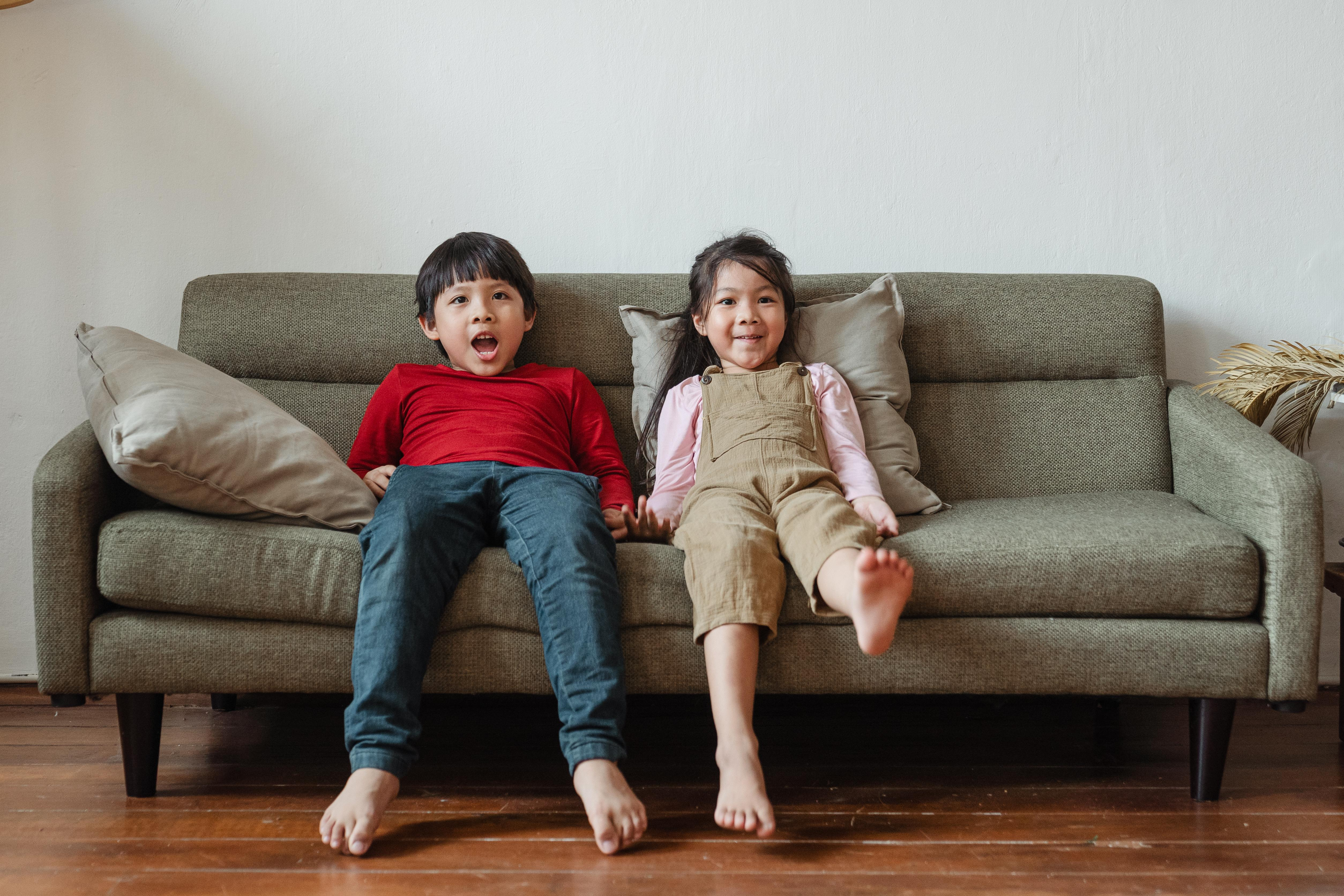 Two kids on a couch
