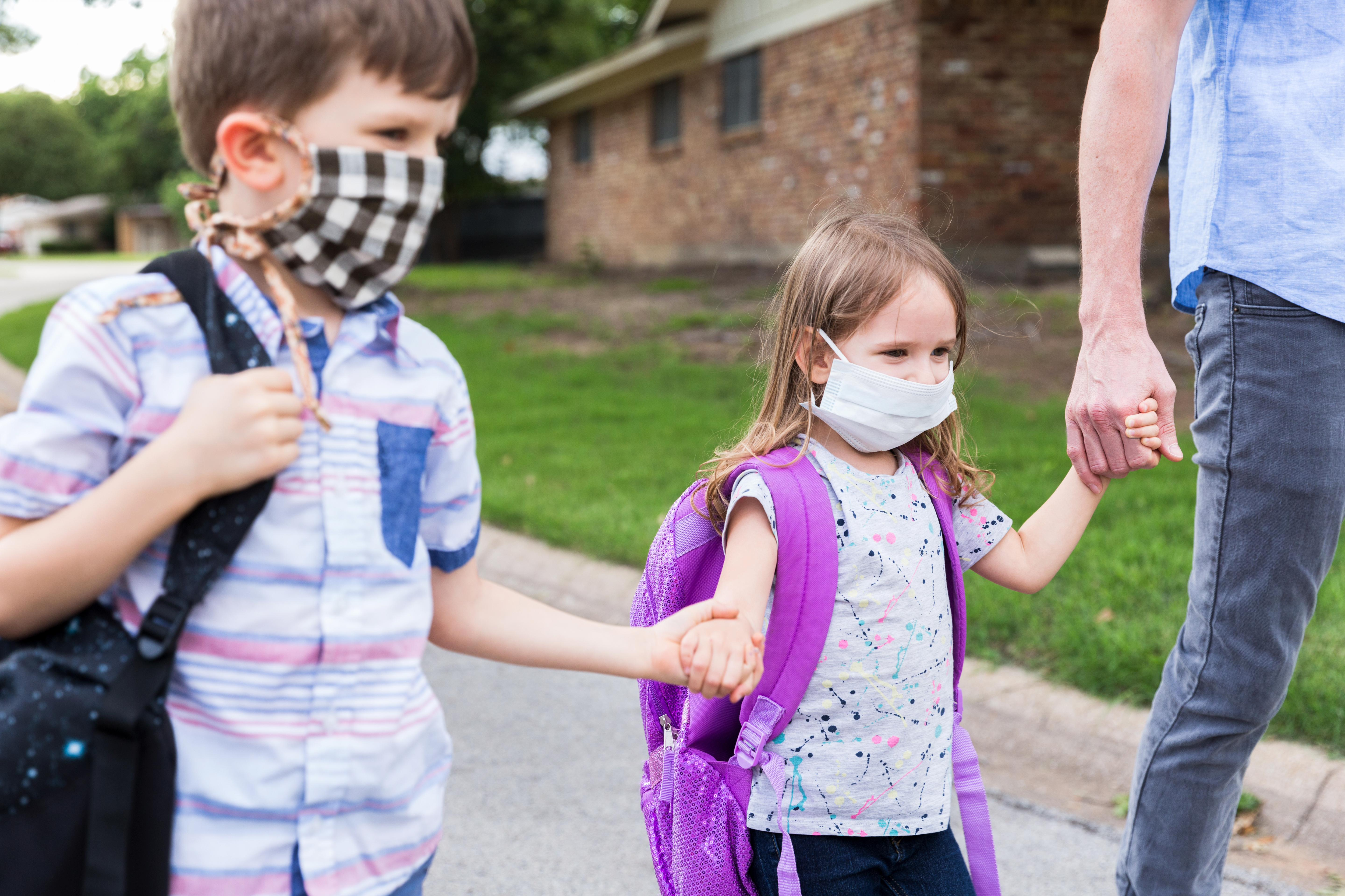 Family heading to school wearing masks