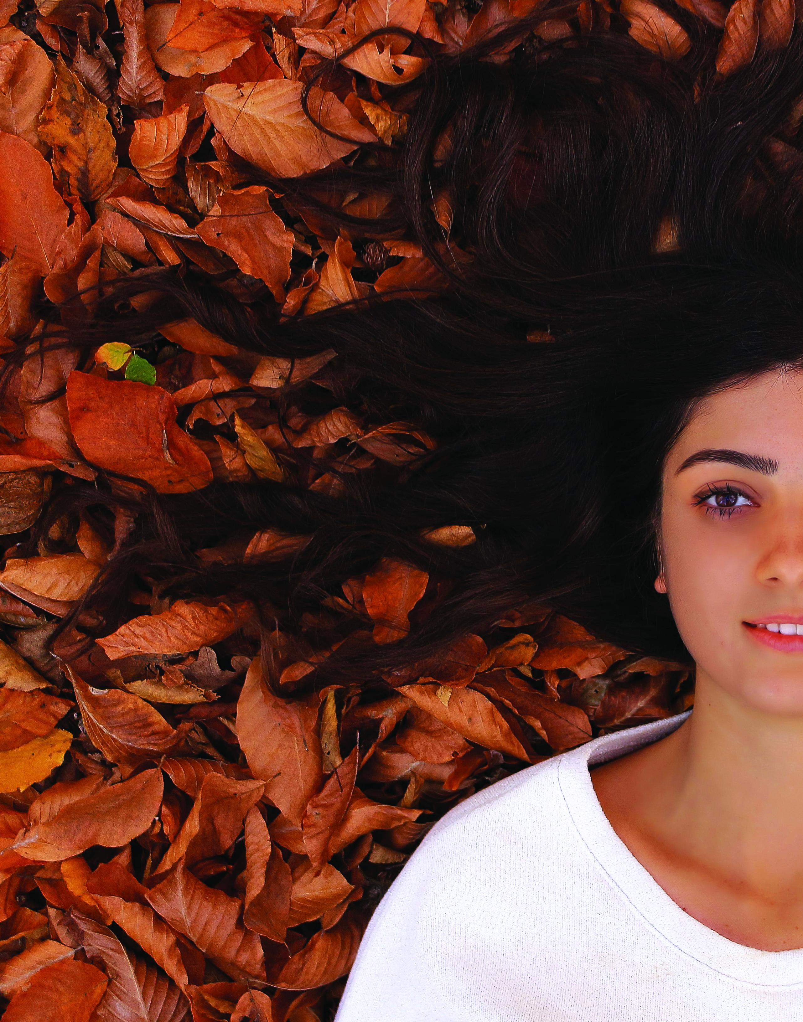 Girl laying in leaves