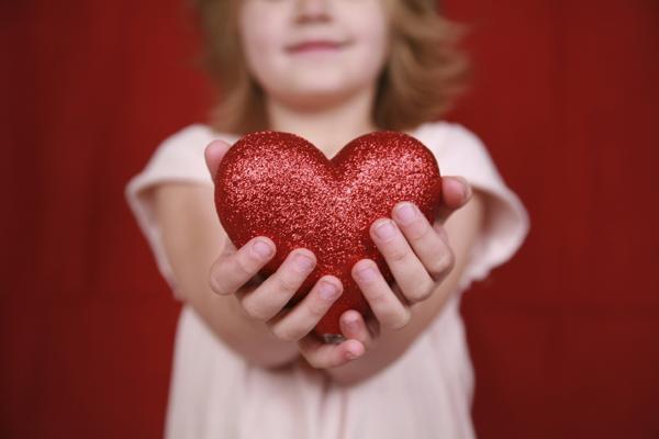 Girl holding heart adoption