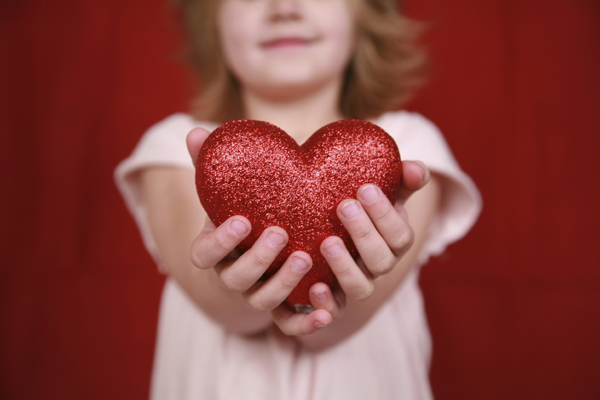 Girl holding heart adoption
