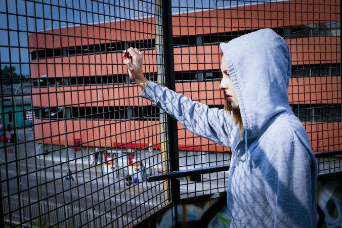 Teen at a fence
