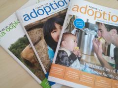 Several copies of Focus on Adoption magazine